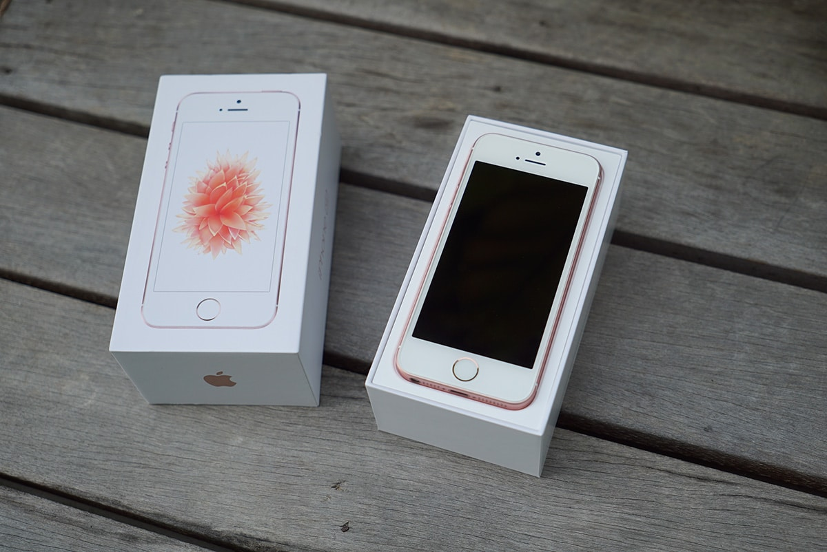 The rose gold iPhone SE comes in a white box