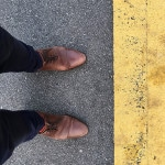 Brown leather shoes worn by the photographer
