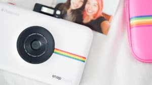 The Polaroid Snap Touch has a built in flash