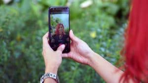 Girl taking selfies with ASUS ZenFone 4 Selfie, screen facing the camera
