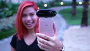Girl taking photo with the Insta360 ONE
